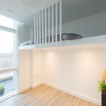 Contemporary wall-to-wall bespoke mezzanine loft with ladder